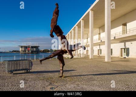 Lisbon Oceanarium's conceptual design, architecture was led by Peter Chermayeff, and Statue of Antony Garmley in Parque das Nações in Lisbon, Portugal - Stock Photo