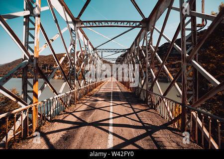 Old steel bridge road over lake in huesca spain - Stock Photo