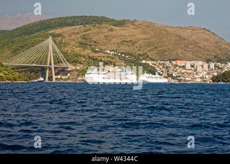 coastal scene, cruise ships; buildings, hillside, Franjo Tudman Bridge; cable-stayed bridge; 1699 feet long; 2002; Dalmatia; Dubrovnik; Croatia; Europ - Stock Photo