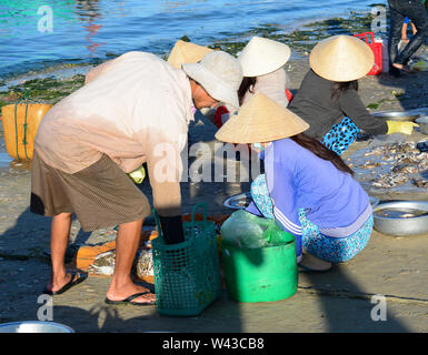 Phan Thiet, Vietnam - Mar 19, 2016. People sell fish at local market in Mui Ne town, Phan Thiet, Vietnam. Mui Ne is a coastal fishing town in the Sout - Stock Photo