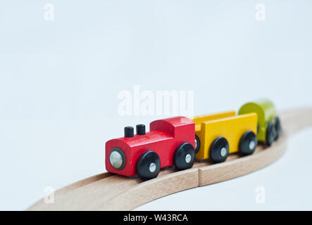 Wooden toy train with colorful blocks.  Educational toys. - Stock Photo