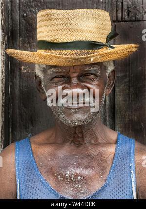 Portrait of a dapper Cuban man wearing a straw hat - Stock Photo