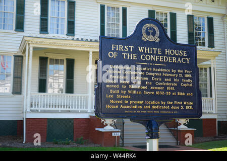 An historical blue metal sign with gold text in front of the First White House of the Confederacy in Montgomery, AL, USA, - Stock Photo