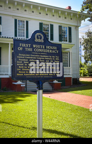 An histoical blue metal sign with gold text in front of the First White House of the Confederacy in Montgomery, AL, USA - Stock Photo