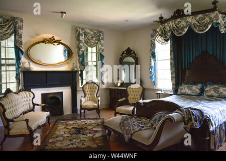 Elaborate bedroom decor as staged for 1861 bedroom inside the First White House of the Confederacy in Montgomery, AL, USA - Stock Photo