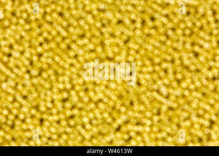Bright yellow light bokeh background. Multi colored bright lights. - Stock Photo