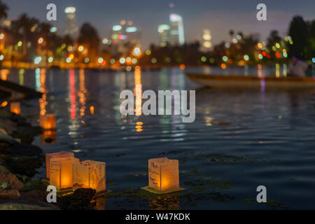 Close up of many lantern with downtown skyline in Lotus Festival Echo Park at Los Angeles, California - Stock Photo