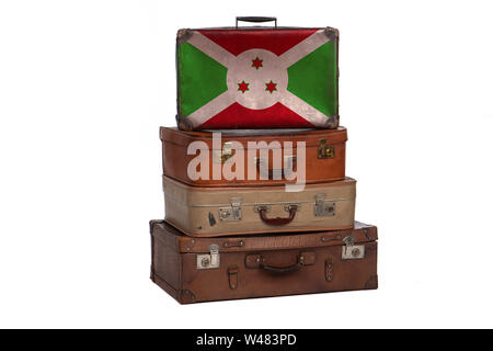 Burundi, Burundian travel concept. Group of vintage suitcases isolated on white background - Stock Photo