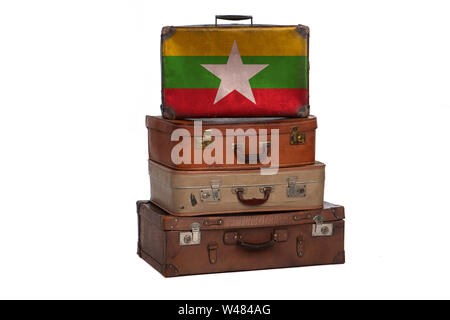 Myanmar travel concept. Group of vintage suitcases isolated on white background - Stock Photo