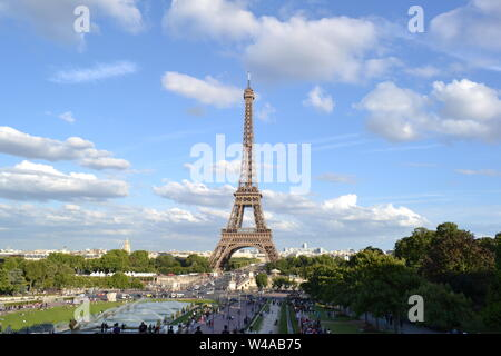 Paris/France - August 18, 2014: Beautiful panoramic view to the fountain of Warsaw and the Eiffel Tower from Trocadero gardens viewpoint. - Stock Photo