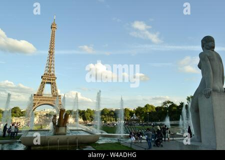 Paris/France - August 18, 2014: View to the statue called Woman, la Femme, of the fountain of Warsaw and the Eiffel Tower in the background. - Stock Photo