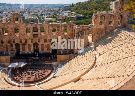 Athens, Greece - September 26, 2011: View of the Odeon of Herodes Atticus (also called Herodeion). It is a stone theatre structure located on the sout - Stock Photo