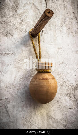 Clay jug hanging on the wall in the Arab room. - Stock Photo
