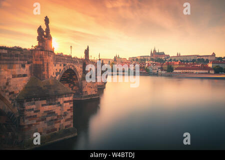 Sunset view over Charles Bridge (Karlov Most), Vltava river and Prague Castle in summer in Prague, capital of Czech Republic - Stock Photo