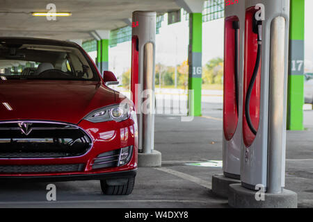 Tesla Model S parked at Tesla Supercharger in Montreal, Quebec (Place Ventu) - Stock Photo