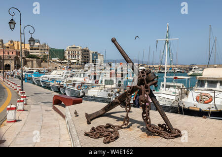 Fishing boats and yachts in the Old Venetian Harbour, Heraklion, Crete, Greece - Stock Photo