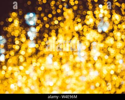 Blurred Christmas lighting backdrop. Bright Christmas Street Illumination on the facade of the buildings. Burning lanterns on Nikolskaya street in - Stock Photo