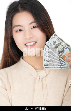 Beautiful Chinese American woman posing with American Money isolated on a white background - Stock Photo