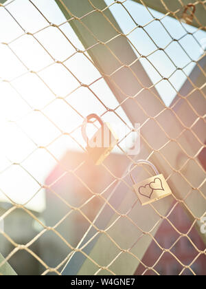 Austria, Wattens, golden love lock with hearts - Stock Photo