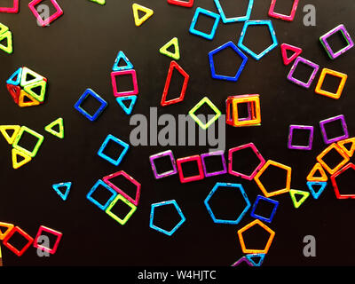 Many magnets are stuck on the blackboard. - Stock Photo