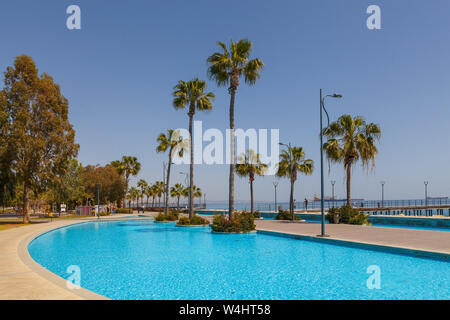 LIMASSOL, CYPRUS - MAY 10, 2018: Molos promenade on the coast of Limassol city in Cyprus, day time - Stock Photo