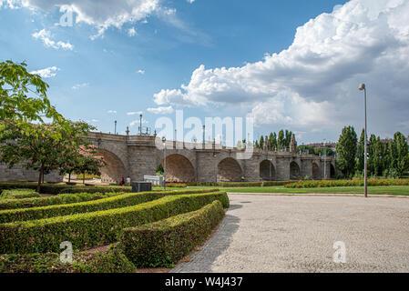 Bridge of Toledo a Baroque style bridge spans the Manzanares river in Madrid, Spain - Stock Photo