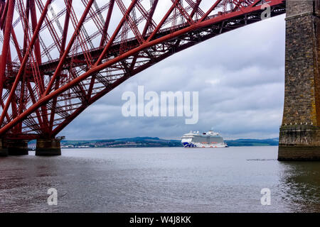 Edinburgh, Scotland - August 13, 2018:  Princess cruise ship, the Royal Princess, anchored in the Firth of Forth with the Forth Bridge overhead. - Stock Photo