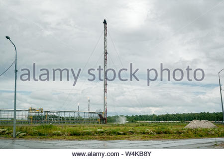 Tobolsk, Russia - July 15. 2016: Sibur company. Petrochemical Industrial Complex. Torches for burning of associated gas - Stock Photo