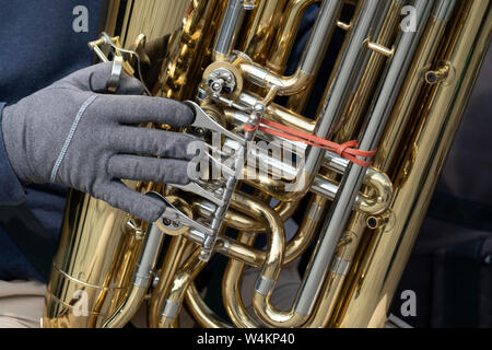 street artist playing banjo musician detail of hands close up - Stock Photo