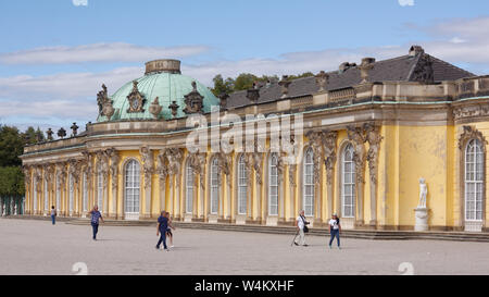 People in front of Sanssouci palace in Potsdam, Germany. Sanssouci Palace is the part of UNESCO World Heritage site since 1990 - Stock Photo