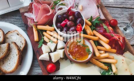 Mediterranean mixed platter to share with a selection of meats and cheeses - Stock Photo