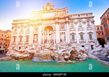 Majestic Trevi fountain in Rome sun haze view, eternal city, capital of Italy - Stock Photo
