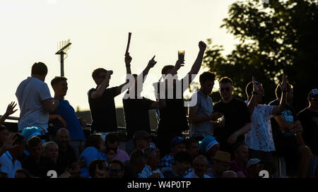 Hove Sussex UK 24th July 2019 - Fans enjoy the evening sunshine during the Vitality Blast South Group Match between Sussex Sharks and Hampshire at the 1st Central County Ground in Hove  . Credit : Simon Dack / Alamy Live News - Stock Photo