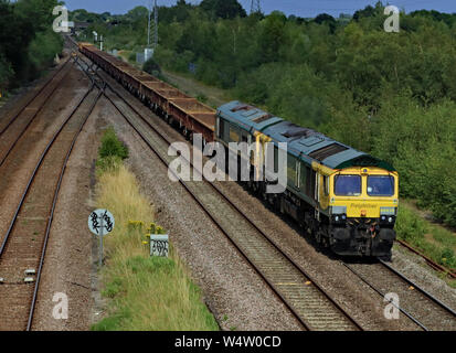 Freightliner locomotives no's 66416 and 66613 pass North Stafford Junction in near Willington in Derbyshire hauling a freight train. - Stock Photo