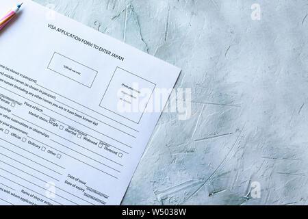 Filling the Visa application form to enter Japan. - Stock Photo