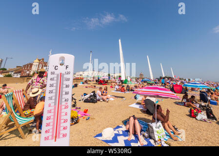 FAKE IMAGE. Jubilee Beach, Southend on Sea, Essex, UK on a day when temperatures reached record levels. Thermometer altered to read 50 degrees Celsius - Stock Photo