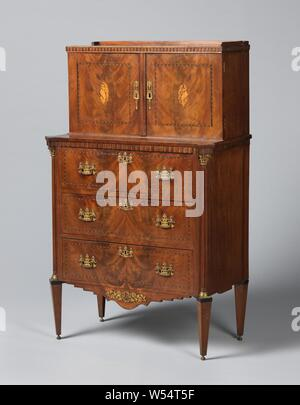 Cupboard with two doors and three drawers, glued with mahogany. On the doors a central oval shell motif, Oak cabinet with wall cabinet, glued with mahogany. The conical legs and the corner posts, with fluted half-columns with copper base and Corinthian capital, are placed at right angles. The three drawers of the base cabinet carry gilt copper fittings in the form of vases with hanging garlands. These drawers and the two doors of the wall cabinet bear rectangular and square fields marked by bands with herringbone motif, a central oval shell motif on the doors. Scalloped bottom rail with batter - Stock Photo