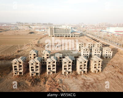 A view of a ghost town with unfinished complex including a boat-shaped building in Yangxin county, Binzhou city, east China's Shandong province, 17 Fe - Stock Photo