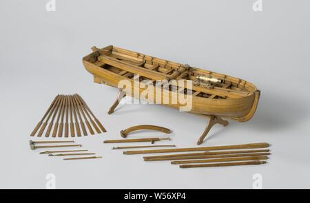 Model of an Armed Longboat, Truss model with round wood on a stand. Smooth-edged double-belted barkas, round truss with flat sheer and flat mirror, a forecourt, seven dulls and rails and an open cabin with side vents. The prow is coppered and has a disk. Three-part frames. Simple rudder with a tiller that fits over the rudder king. The rig consists of a large mast with ra for a bucket sail and a grape mast with a parrot pole and whip. The barkas is armed with a carronade on a loose sledge, which extends from the front to the stern. On separate parts there is also a hand pump, a boat hook - Stock Photo