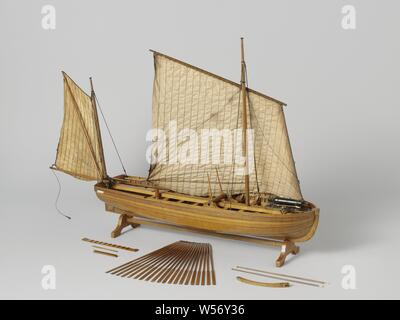 Model of an Armed Longboat, Tested truss model on a standard. Smooth-edged double-belted barkas, round truss with almost flat sheer and flat mirror, a forecourt, nine diets and eight rails and an open cabin with side dents. Midships a roasting spindle including a tapered square wooden tube with a hole through the skin: heavy anchors were lifted. The prow is coppered and has a disk. Three-part frames. Simple rudder with a tiller that fits over the rudder king. The rig consists of a large logger sail and a sprit sail with parrot pole as a drip. The bottom carriage of the carronade consists - Stock Photo