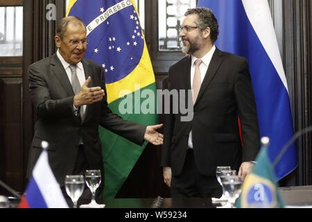Brazilian Chancellor Ernesto Araujo (R) meets his russian counterpart Segey Lavrov (L) during a bilateral encounter after a meeting with BRICS forum countries (Brazil, Russia, India, China and South Africa) in Rio de Janeiro, Brazil, 26 July 2019. The BRICS countries agreed that the solution to the crisis in Venezuela has to be driven by Venezuelans themselves, constitutionally and peacefully, and without external interventions. EFE/ Marcelo Sayao - Stock Photo