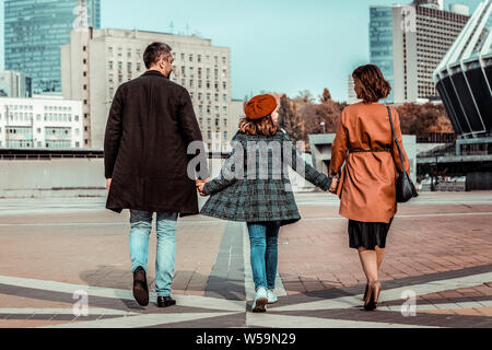 Young family. Cheerful girl being in all ears while listening to her mother - Stock Photo