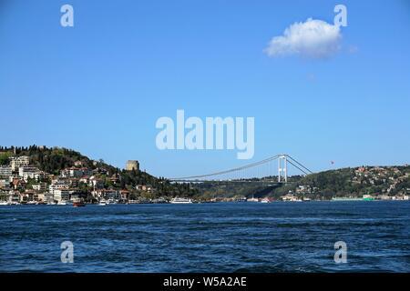 Fatih Sultan Mehmet Bridge and Rumelihisarı Fortress on the Bosphorus, located in Istanbul, Turkey. - Stock Photo
