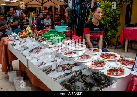 Fresh Seafood and Meat Dishes Displayed Outside A Beachfront Restaurant, Alona Beach, Bohol, The Philippines - Stock Photo