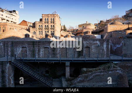 Facades and domed roofs of the royal bathhouse in the Abanotubani area. Old town, Tbilisi, Georgia, Caucasia, Eurasia - Stock Photo