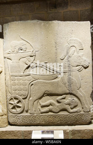 ANKARA, TURKEY - MAY 21, 2014 -  Chariot with driver and archer. Orthostat stele from Kargama about 800 BCE,  Ankara, Turkey - Stock Photo