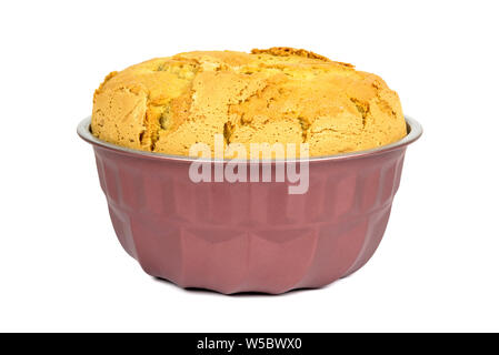 Whole bundt cake in a form isolated on white background with clipping path - Stock Photo