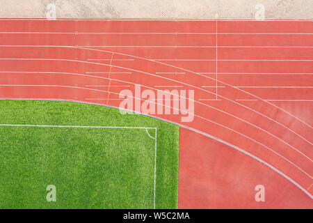 red athletics running track at the stadium. aerial top view - Stock Photo