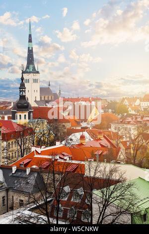 Tallinn, Estonia. Cityscape skyline with historic buildings, red tile and st Olaf church - Stock Photo