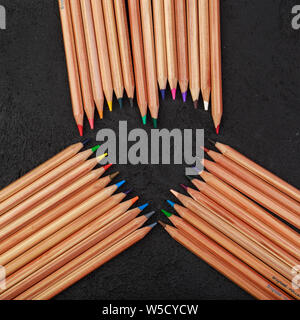Background from color pencils on black background - Stock Photo